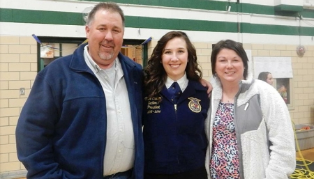 Chloe Carson pictured with her parents