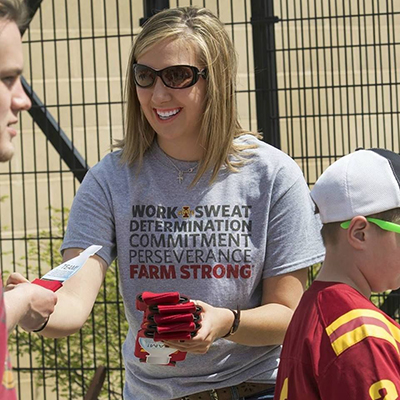 Chloe greeting Iowa State Cyclone fans with farm and water quality facts at Jack Trice Stadium in Ames, Iowa.